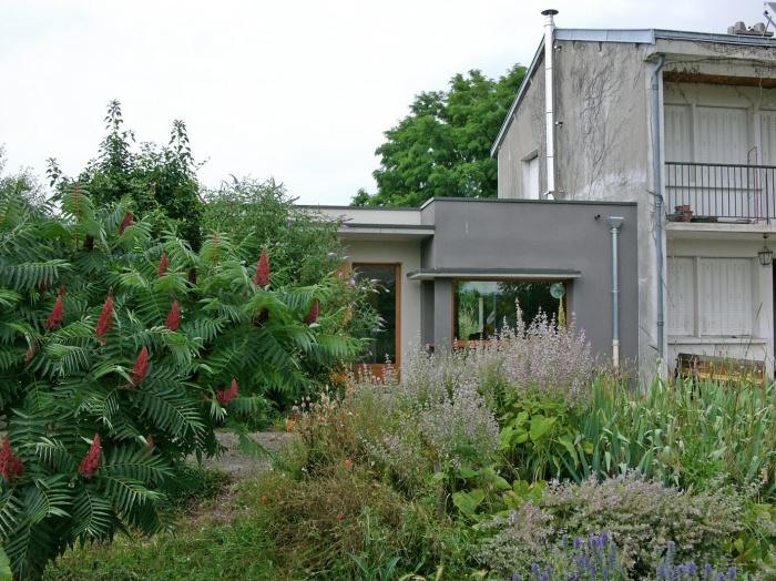Rénovation et extension écologique très haute performance énergétique.