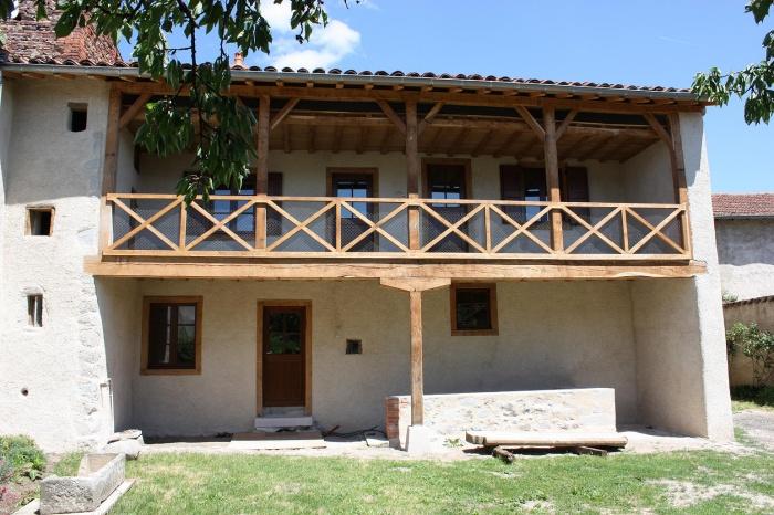Restauration maison Javogue : Façade principale avec sa galerie